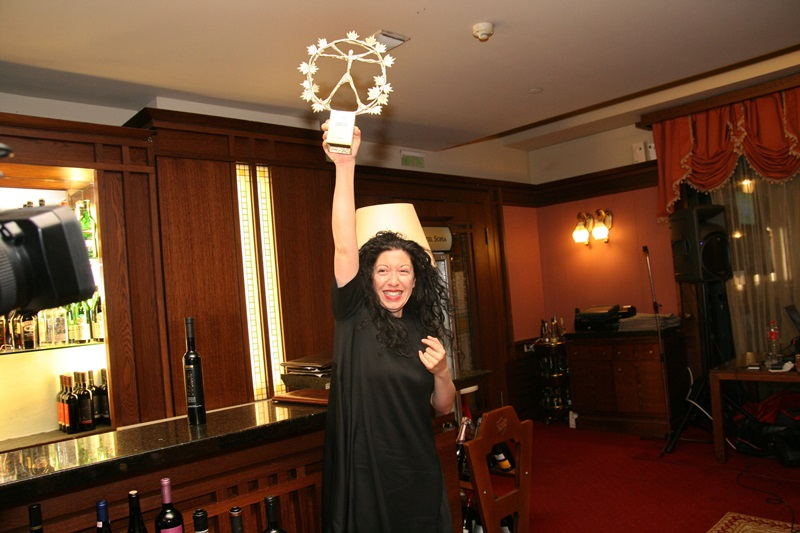 Panagiota Kalogeropoulou from Domaine Sigalas receiving the Grand Trophy